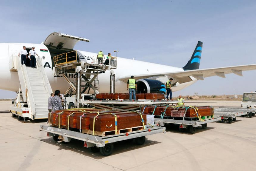 Coffins containing the remains of the bodies of Egyptian Copts killed by ISIS in Sirte are loaded to the plane to be transferred to Egypt, in Misrata, Libya on May 14, 2018.