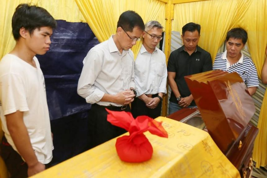 Singapore Civil Defence Force commissioner Eric Yap (second from left) and other officers visited Corporal Kok Chin Yuen's home in Melaka to pay their respects late on May 15, 2018.
