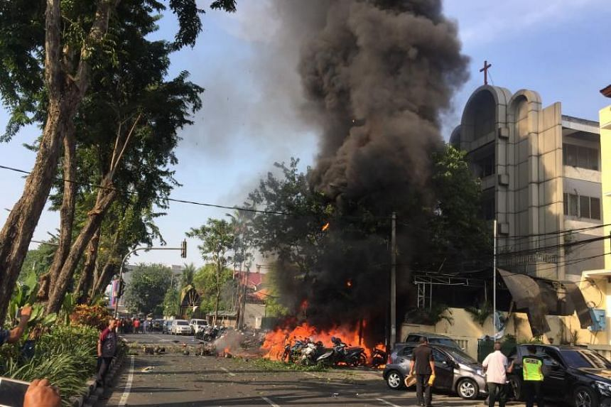 Indonesian police at the site of a blast outside the Surabaya Centre Pentecostal Church in Surabaya on May 13, 2018.