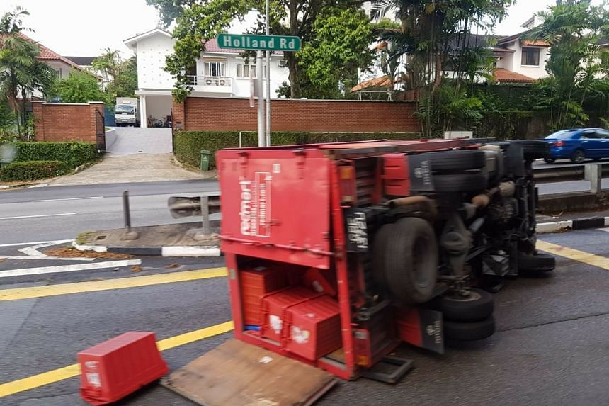 A RedMart lorry flipped on its side near Holland Village on May 14, 2018.