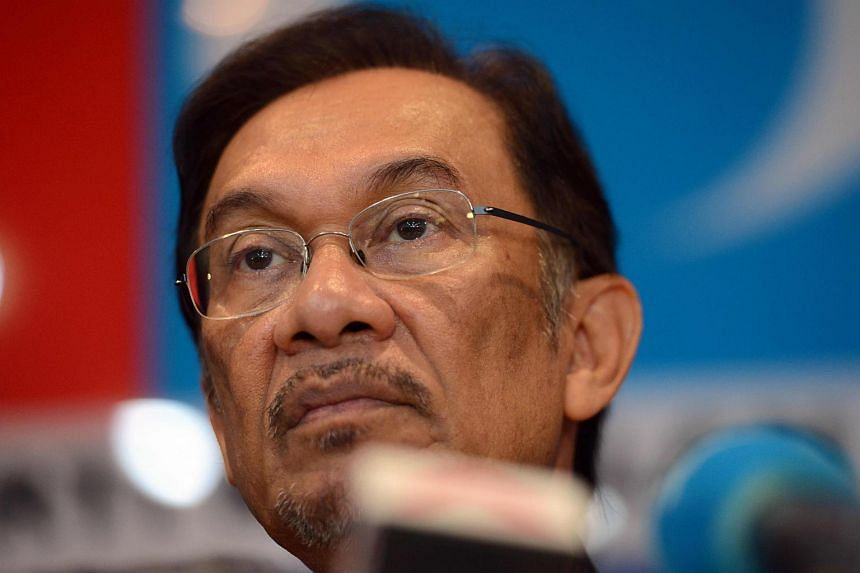 File photo showing Datuk Seri Anwar Ibrahim listening to questions during a press conference at his office in Petaling Jaya.