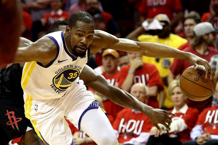 Kevin Durant of the Golden State Warriors handles the ball in the second half against the Houston Rockets on May 14, 2018, in Houston, Texas.