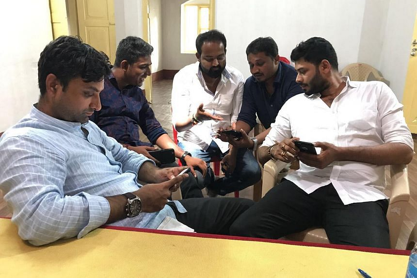 Members of the Bharatiya Janata Party social media team and others, (from left) Mr Vikas Puttur, Mr Prakash Kaushik, Mr Shashank Achar, Mr Uday Amin and Mr Nandan Mallya, at the election headquarters in Mangalore, India.