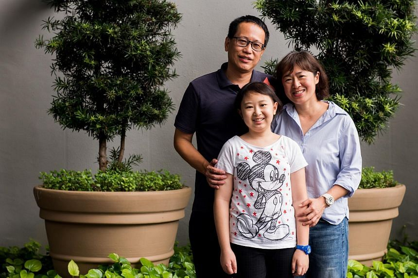 Celeste Chang with her parents, Mr Astro Chang, 49, and Ms Jackie Lee, 47. Celeste is one of the winners of the Singapore Health Inspirational Patient and Caregiver Awards.