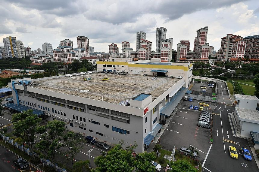 The mostly empty rooftop carpark (above) of ComfortDelGro's CityCab building in Sin Ming Avenue yesterday, and (left) the same carpark filled with taxis last November. The taxi giant has around 13,000 cabs now, down from a high of over 17,000.
