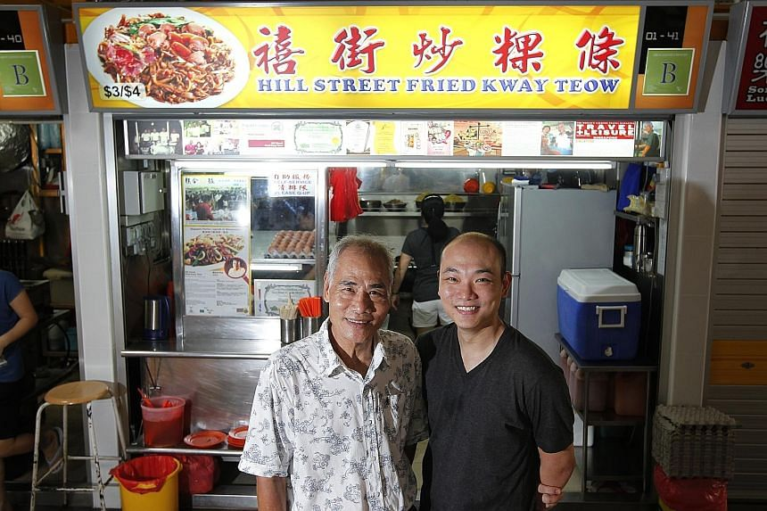 Mr Ng Chang Siang (left), owner of the popular Hill Street Fried Kway Teow at Block 16 Bedok South Road, with his son, Mr Ng Yeow Kiat, in a 2013 photo.