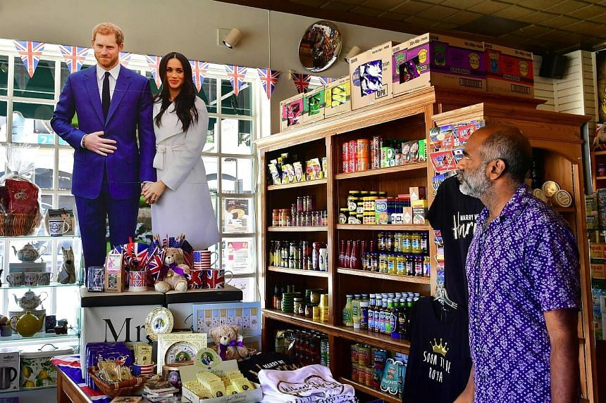 A cardboard cutout of Prince Harry and Ms Meghan Markle overlooking a selection of royal wedding merchandise in Ye Olde Kings Head gift shop in Santa Monica, California. The couple are due to be married on Saturday at Windsor Castle in England.