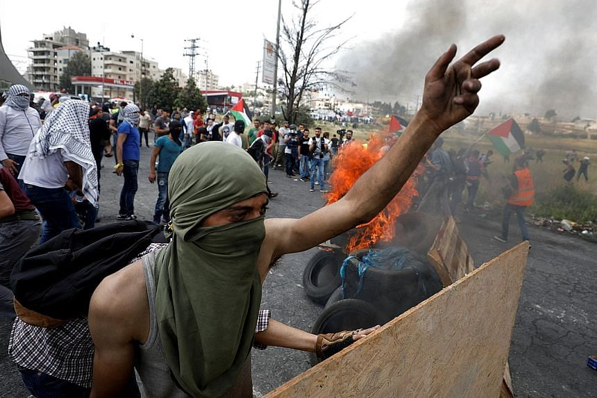 A Palestinian man gesturing during a protest marking the 70th anniversary of Nakba, near the Jewish settlement of Beit El, near Ramallah, in the occupied West Bank yesterday.