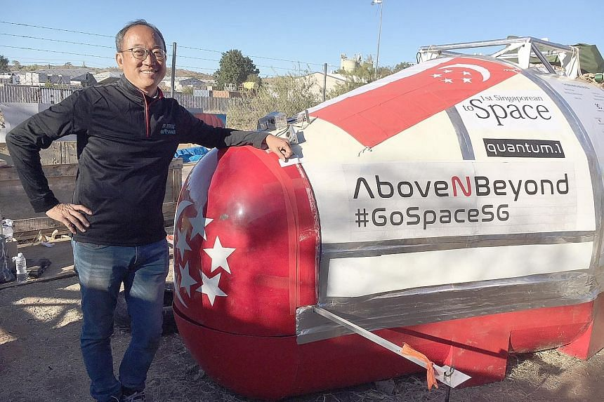 Mr Lim Seng with his space capsule. On Monday, an unusually fierce wind crossing central Australia forced him to cancel the launch outside Alice Springs.
