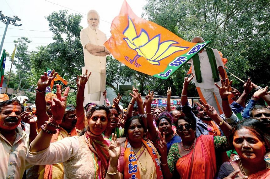 BJP supporters celebrating their party's success in the Karnataka elections in Bangalore yesterday. Both the Bharatiya Janata Party and the Congress have said they will form the state government in an election where much is at stake for them. Without