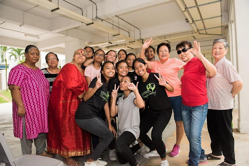 Woodlands Secondary students and some of the elderly residents who live near the school. Unlike other Share a Pot programmes in Singapore, the one in Woodlands is entirely led and run by the students. Student Rainey Kee lives in the same block as som