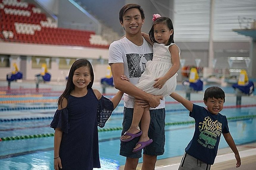 From left: Mikayla, Zachary, 14, Kyra, and Ayden Tan at the OCBC Aquatic Centre, where Zachary used to train and compete. The national swimmer will now train at the Phoenix Swim Club, where Olympic champions like American breaststroker Breeja Larson