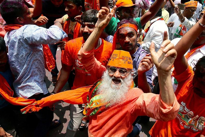 BJP supporters celebrating their better results in the Karnataka state election yesterday.