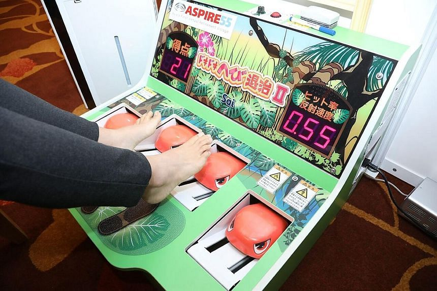 The SmarTable (left) has six games that help to improve memory, accuracy in hand movement and response times of those with cognitive impairment, while The Doki Doki Snake Extermination game (right) is similar to the Whac-A-Mole arcade game. As snakes