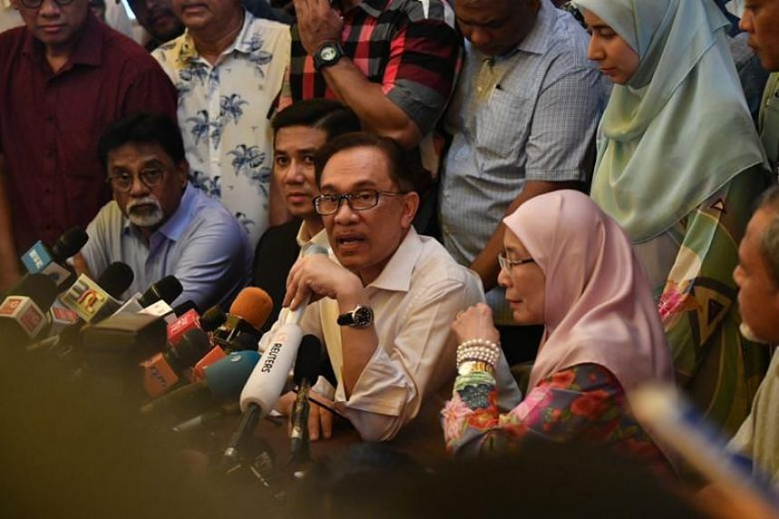 Mr Anwar addressing the media in his first press conference since receiving royal pardon.