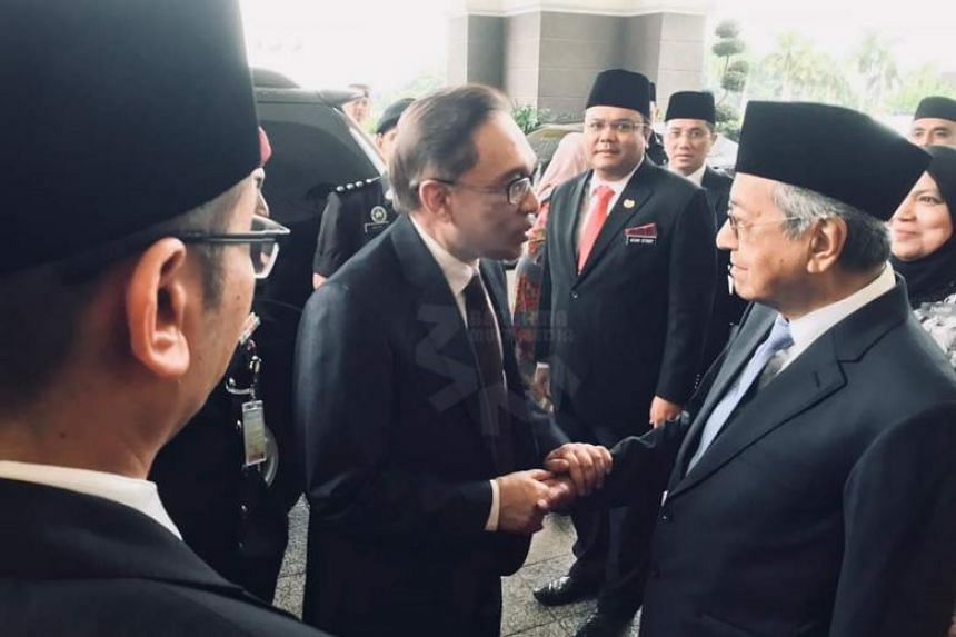Mr Anwar with Malaysian Prime Minister Mahathir Mohamad at the palace on May 16, 2018.
