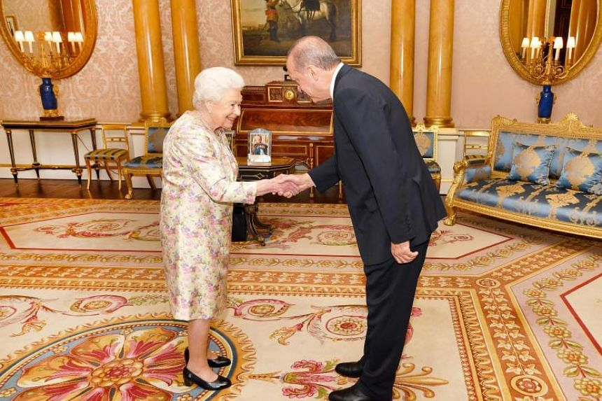 Britain's Queen Elizabeth II (left) greets Turkey's President Recep Tayyip Erdogan during a private audience at Buckingham Palace in London on May 15, 2018.