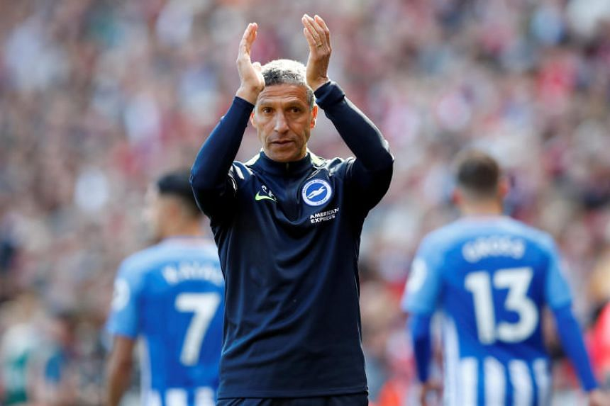 Brighton manager Chris Hughton applauds fans after the match.