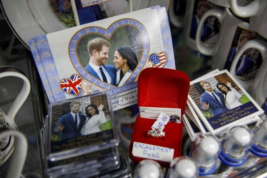 Souvenirs featuring Britain's Prince Harry and his fiance US actress Meghan Markle are pictured in a gift shop in Windsor, London, on April 1, 2018.