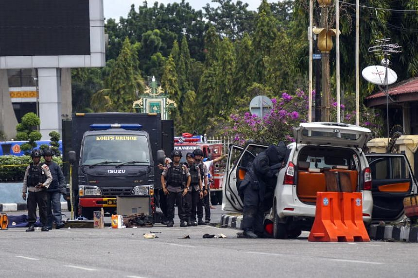 An Indonesian bomb squad searching a vehicle for explosives following an attack on a police headquarters in Pekanbaru, Riau province, Indonesia, on May 16 2018.