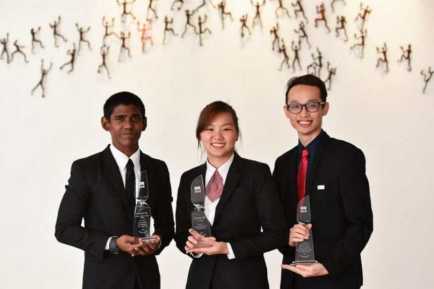 (From left) Puvanaswaran Manikam, Amanda Neo Yan Lin and Aiden Chan Sung Yi receive the prestigious Lee Kuan Yew Technology Award at ITE College Central, on May 16, 2018.