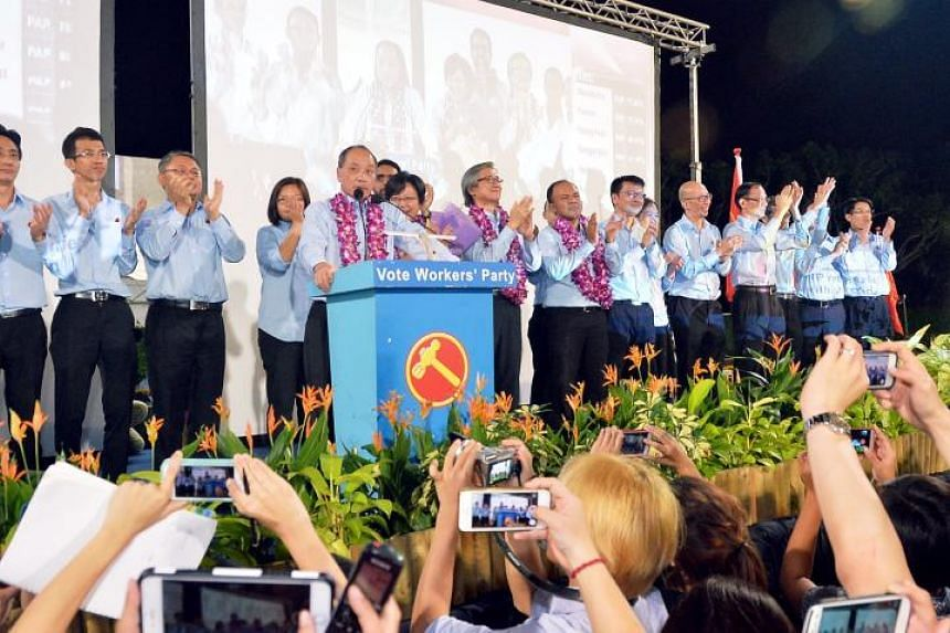 A team from the Workers' Party, lead by former secretary-general Low Thia Khiang, acknowledging their supporters after polling day on Sept 11, 2015.