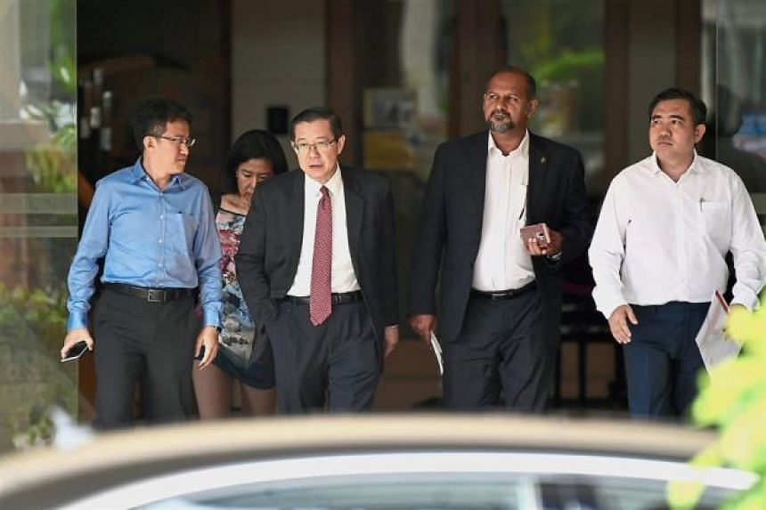 DAP secretary-general Lim Guan Eng (second from left), its deputy chairman Gobind Singh (second from right) as well as party national organising secretary Anthony Loke (right) were seen at Dr Mahathir Mohamad's office.
