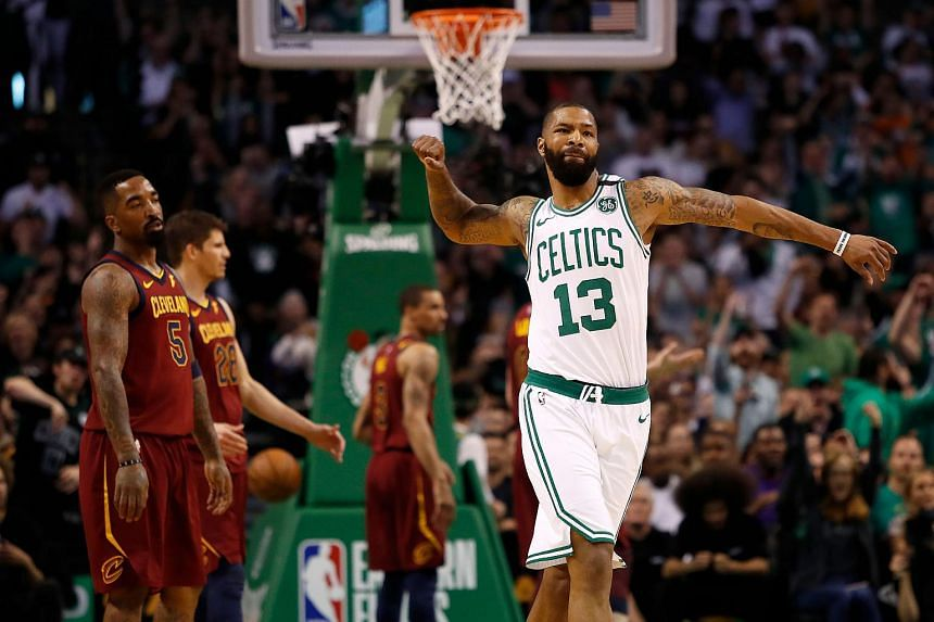 Boston Celtics forward Marcus Morris celebrates a basket as Cleveland Cavaliers guard JR Smith looks on during the first quarter of the Eastern conference finals of the 2018 NBA Playoffs at TD Garden.