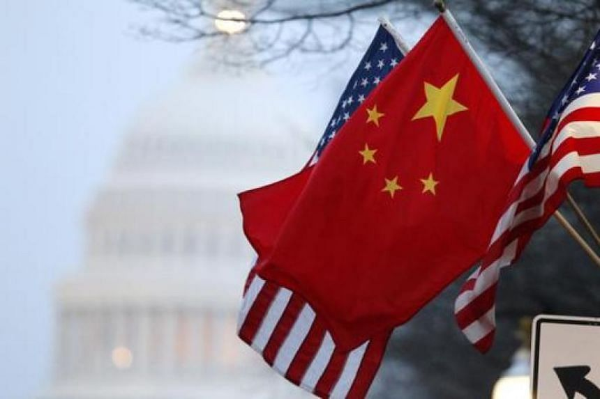 File photo showing the flags of US and China near the US Capitol in Washington.