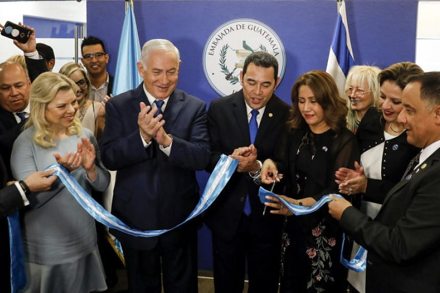 (From left) Sara Netanyahu and Israeli Prime Minister Benjamin applaud as Guatemalan President Jimmy Morales and his wife Hilda Patricia Marroquin cut the ribbon during the inauguration ceremony of the Guatemalan embassy in Jerusalem on May 16, 2018.