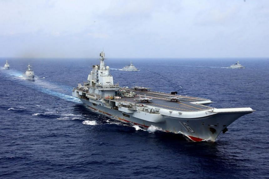 China's aircraft carrier Liaoning takes part in a military drill of in the western Pacific Ocean on April 18, 2018.