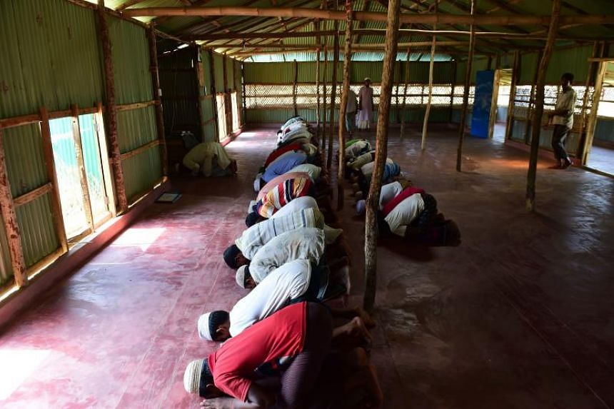 Rohingya men offering their afternoon prayers at a refugee camp in Ukhia, Cox's Bazar, on May 10, 2018.