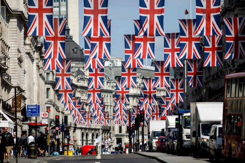 Union Jack decorations are seen in Regent Street, London on May 11, 2018, ahead of the royal wedding of Prince Harry and US actress Meghan Markle.
