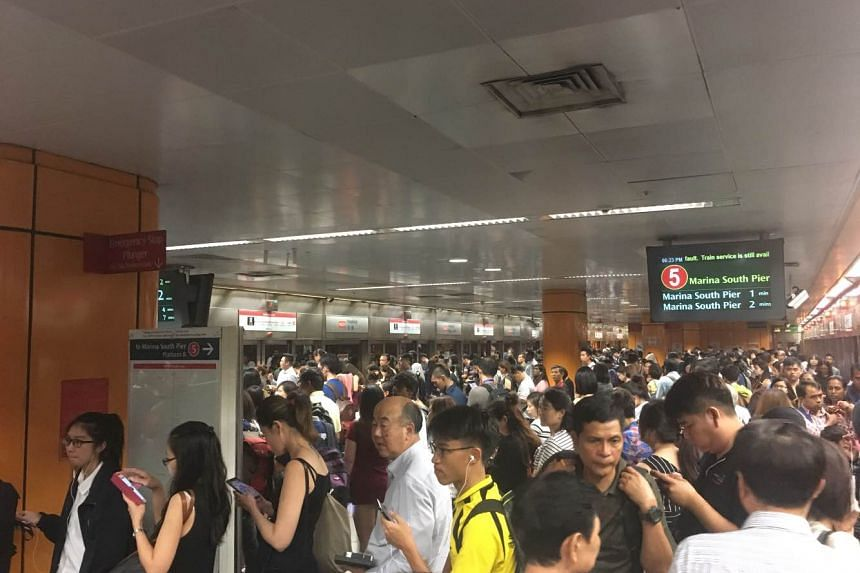 The scene at Newton station along the North-South Line. SMRT said commuters should expect additional 25-minute travel time due to platform screen door fault.