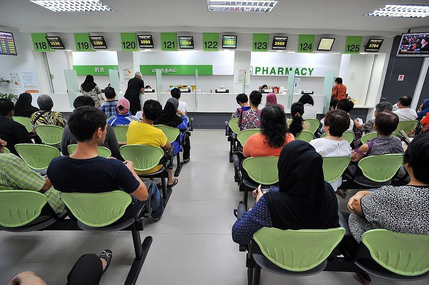Patients waiting to pick up their medicine at the pharmacy in Tampines Polyclinic. Dr Chia Shi-Lu, who chairs the Government Parliamentary Committee for Health, said most Singaporeans still visit their family doctor or GPs rather than polyclinics for
