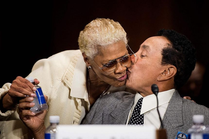 Singer Dionne Warwick with singer Smokey Robinson (both left) during a recent hearing on copyright protection in Washington, DC.