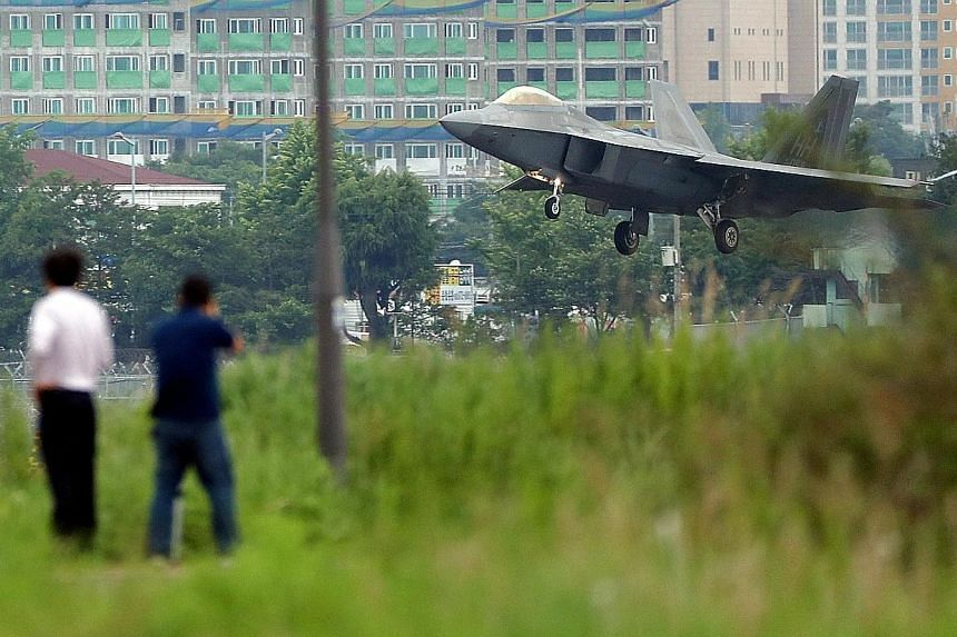 A US Air Force F-22 Raptor fighter jet landing in Gwangju, South Korea, yesterday. The Pentagon has downplayed ongoing military exercises with South Korea, describing them as routine and defensive.