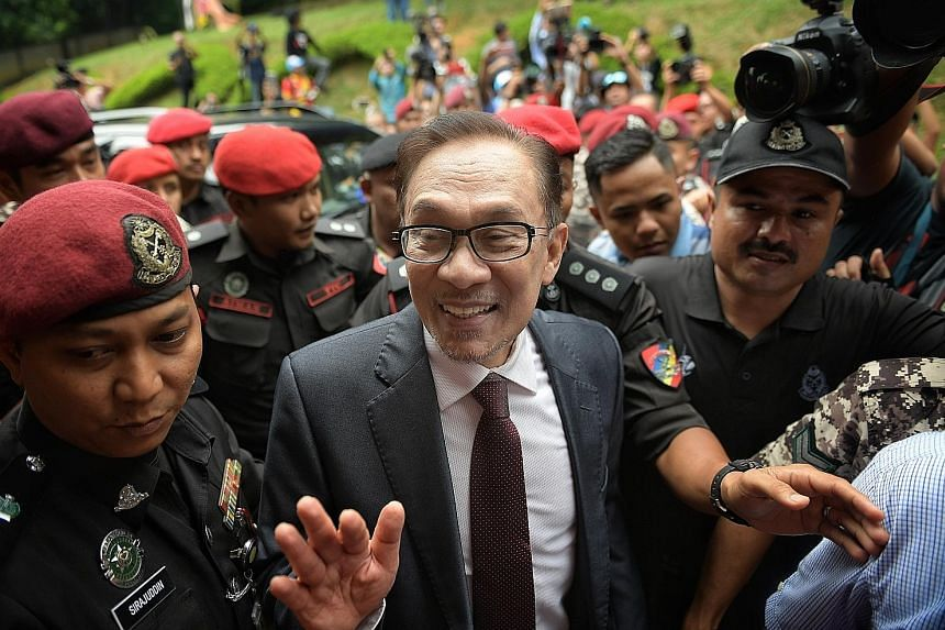 Mr Anwar arriving at his home in Segambut, Kuala Lumpur, after his release from Cheras Rehabilitation Hospital yesterday. Datuk Seri Anwar Ibrahim speaking at a rally attended by thousands of people in Petaling Jaya yesterday evening, in his first pu