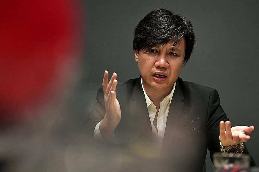 Entertainment lawyer Samuel Seow, 45, who also owns artist management firm Beam Artistes, giving a press conference at his office yesterday, in response to the allegations against him.