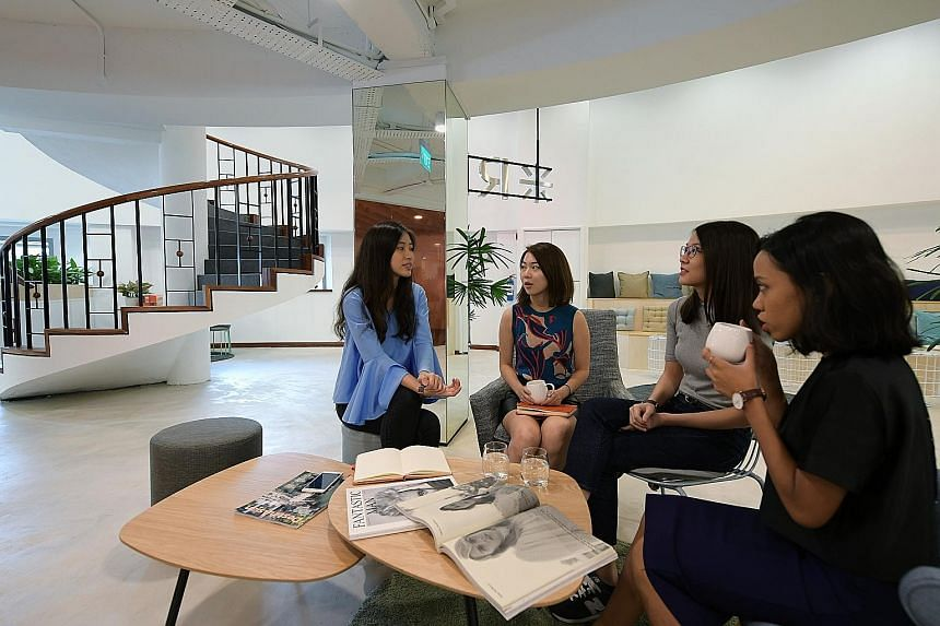 """Ms Huien Lim (second from left), 24, chatting with colleagues. Ms Lim changed jobs three times in two years before landing her """"ideal"""" job in public relations. A study has found that, like her, four in five young professionals in Singapore have felt"""