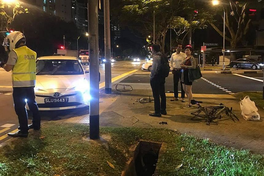 The Straits Times understands the incident happened after a black BMW hit the white car in front of it while turning at the junction. The white car then mounted the pavement and hit the bicycle. The cyclist was taken conscious to hospital, police sai