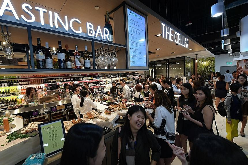A tasting bar at the new Cold Storage outlet at Fusionpolis. In line with the communal and experiential concept of the retail hub, the supermarket added two function rooms and a place where people can dine.