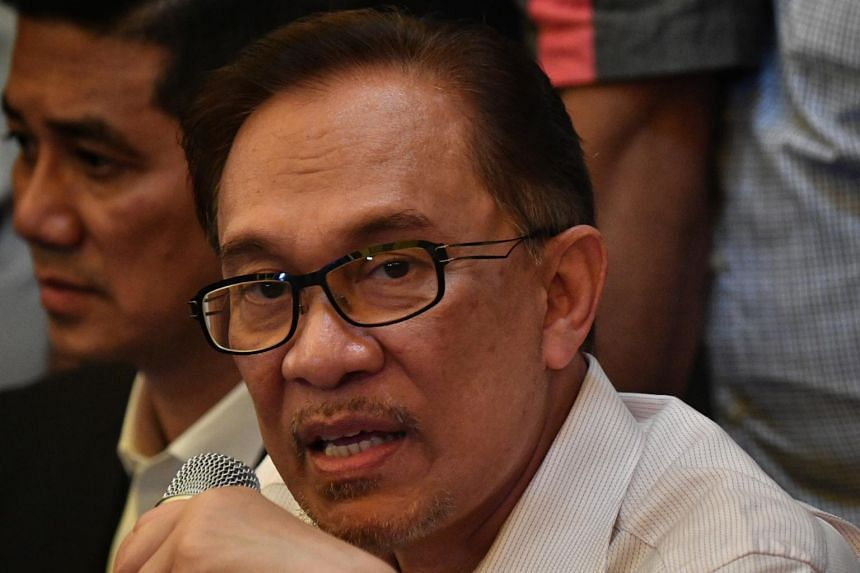 Reformist politician Anwar Ibrahim (pictured) suggested that the policeman, Sirul Azhar Umar, should be brought back to Malaysia for a fresh trial.