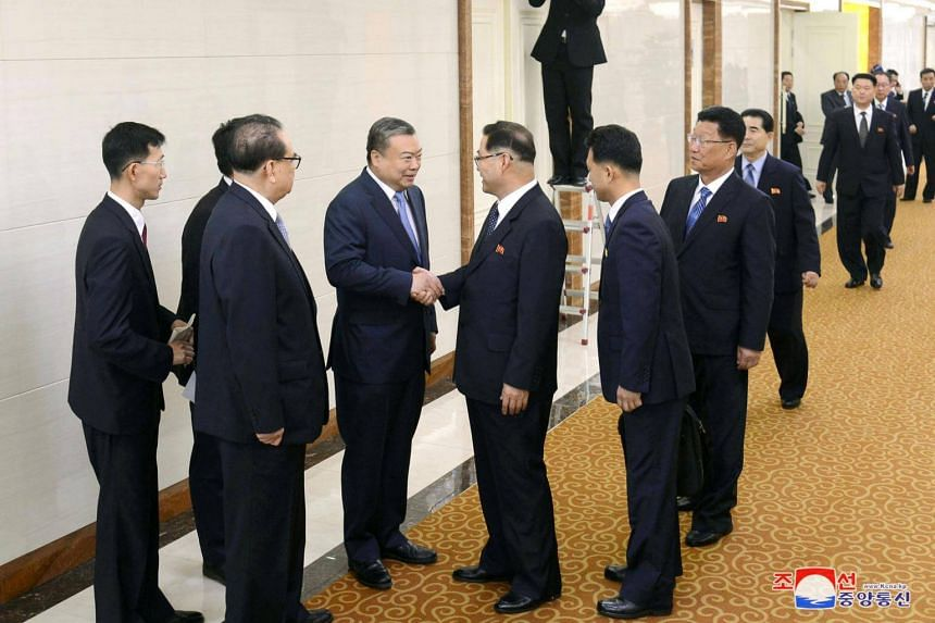 Pak Thae Song, member of North Korea's Political Bureau and vice-chairman of its Central Committee, shakes hands with Chinese Ambassador to North Korea Li Jinjun on May 15, 2018.