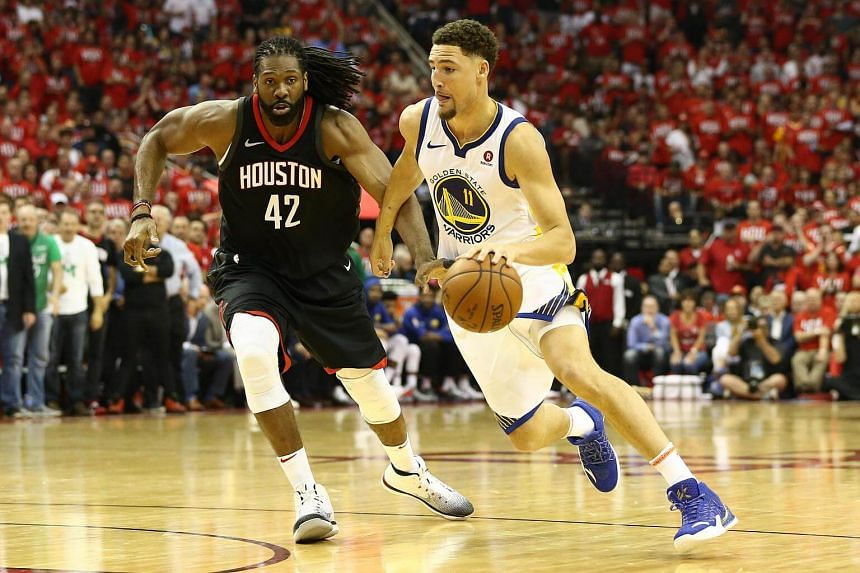 Golden State Warriors guard Klay Thompson dribbles against Houston Rockets center Nene Hilario during the fourth quarter in game one of the Western conference finals of the 2018 NBA Playoffs at the Toyota Center in Texas, on May 14, 2018.