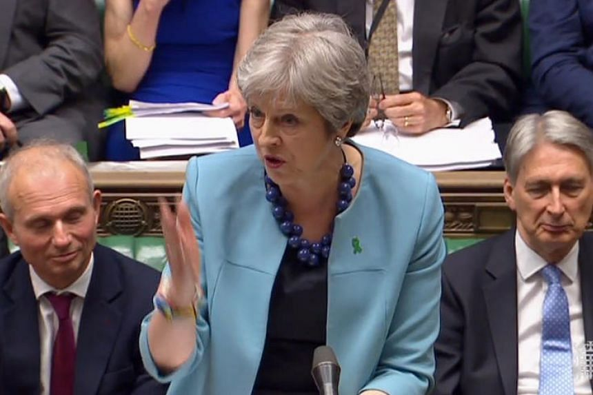 Britain's Prime Minister Theresa May as she speaks during Prime Minister's Questions (PMQs) in the House of Commons in London on May 16, 2018.
