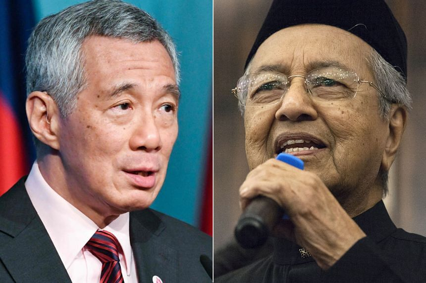 Malaysian Prime Minister Mahathir Mohamad (right) said he will discuss any issues raised by his Singapore counterpart Lee Hsien Loong.