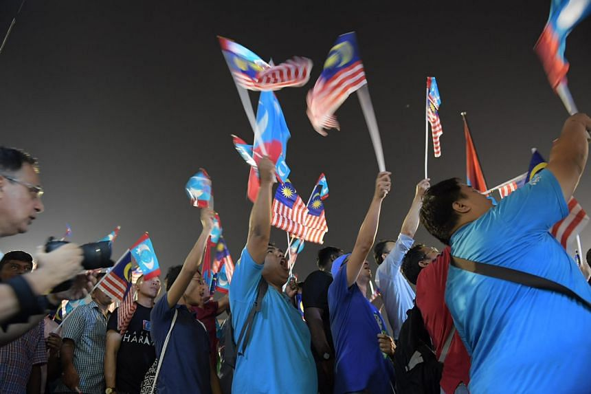 Several thousand supporters filled the Padang Timur field in the Petaling Jaya suburb of Selangor to listen to opposition leader Anwar Ibrahim on May 16, 2018.