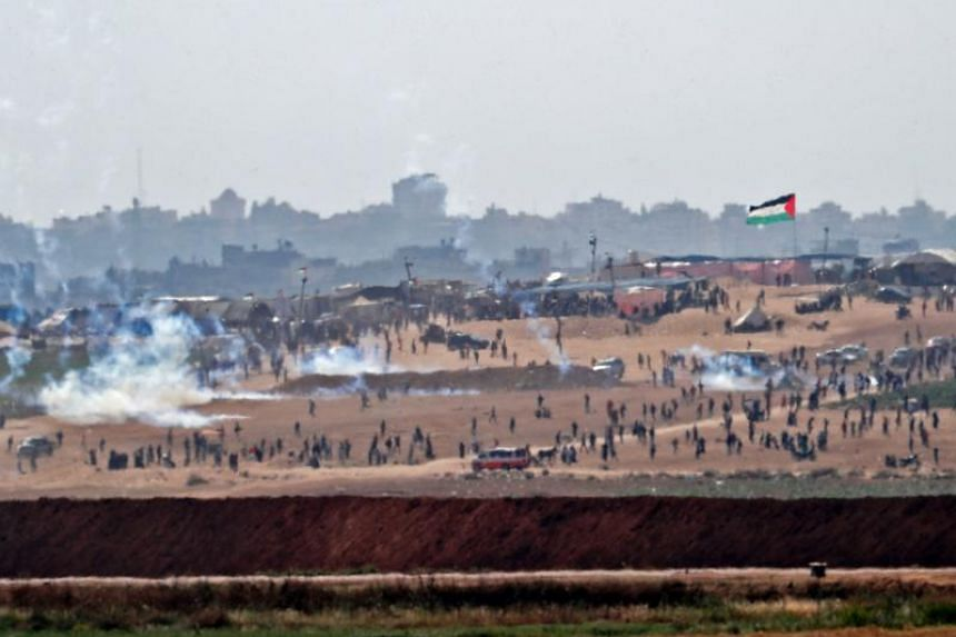 Palestinians protest near the border east of the northern Gaza strip of Beit Hanun on May 15, 2018.