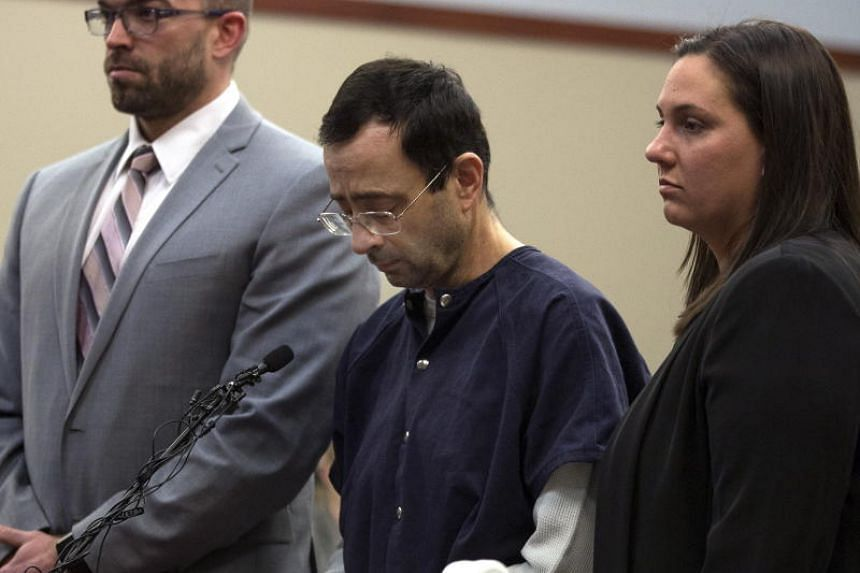 Larry Nassar (centre) listens to the judge during the sentencing phase of court proceedings in Lansing, Michigan, on Jan 24, 2018.